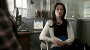 Lucy Liu embraced winter whites on 'Elementary' in a simple cardigan.