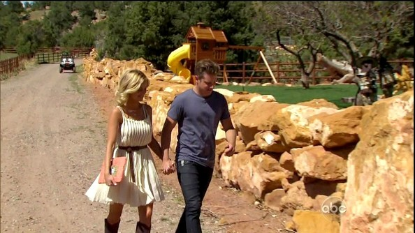 Emily went country on 'The Bachelorette' in this cream pleated dress she belted and wore with knee-high cowboy boots.