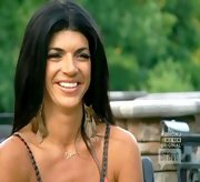 Teresa Giudice hopped on the feather trend with a pair of collar-bone skimming earrings.