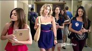 Ashley Benson kept her school style summery on 'Pretty Little Liars' with a slouchy straw tote.