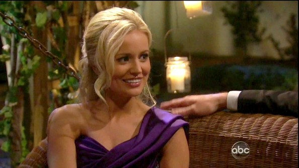 Emily Maynard matched the drama of her evening gown with a curled and backcombed ponytail.
