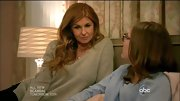 Connie Britton opted for an oversized V-neck sweater in a soft gray tone for her casual look on 'Nashville.'