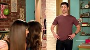 Max Greenfield shows off his muscles in a tight mauve T-shirt, kept classic with a pair of dark blue jeans.