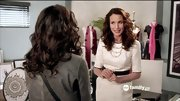 Andie MacDowell looked chic and professional on 'Jane by Design' in a belted sheath dress.