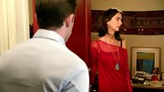 A long turquoise pendant necklace was an exotic addition to Rebecca Reid's sheer red sweater.