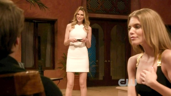 Sarah rocked this little white racer-front dress with soft curls.
