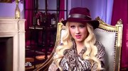 Christina Aguilera loves a stylish hat! This maroon one has loads of character.