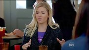 Elisha Cuthbert fought the chill on 'Happy Endings' in a glittery coat.