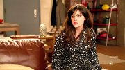 Zooey Deschanel cozied up in one of her favorite prints–polka dots!