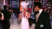 Emily VanCamp chose an elegant white cocktail dress with a deep V-neck for her sexy look at the Graysons' masquerade ball on 'Revenge.'