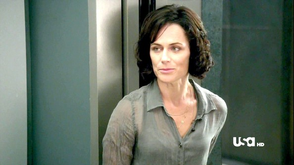 Sarah Clarke showed a hint of skin in a slightly sheer sage green bouse.