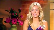 Emily Maynard gave her Ikat maxi dress a little extra bling with gold dangle earrings.