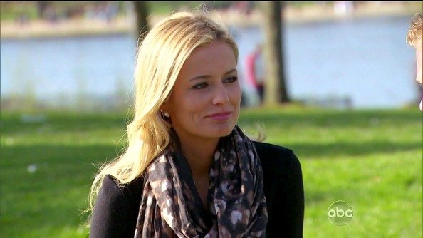 Emily Maynard made a black sweater dress more interesting with the addition of a abstract print scarf.