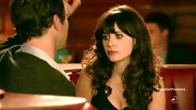 Zooey Deschanel added to her retro vibe on 'New Girl' with big, slightly messy curls and parted bangs.