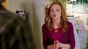 Jayma Mays sported a pink crewneck sweater with bow and a brooch for her classic Emma Pillsbury look on 'Glee.'