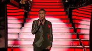 A shiny blazer elevated Joshua Ledet's basic slacks and shirt.