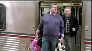 Eric Stonestreet adds flair to his jeans with a purple v-neck sweater and lavender button-up.