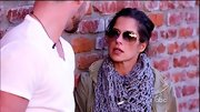 Kelly Monaco kept warm by layering a cozy gray snood over her army jacket.
