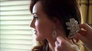 Ashley Hebert kept her bridal style romantic with dangling hoops and a rhinestone-encrusted floral pin.
