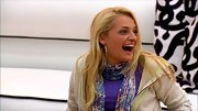 Ali Stroker's floral scarf tied together a heather purple shirt and simple hoodie.
