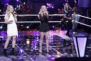 Alex Peot wore a stylish black romper for her performance on 'The Voice'.