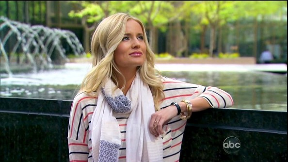 Emily Maynard made a striped dolman top special with a print scarf and stacked gold bangles.