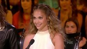 Jennifer Lopez's wild mane of curls were center-parted and pinned away from her face.