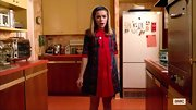 Kiernan Shipka chose a bright red frock and matching plaid petticoat for her look on 'Mad Men.'
