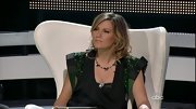 Just in case her confusing sequined vest-meets-cowl neck top wasn't enough, Jennifer Nettles threw on a couple of silver necklaces for that little something extra.