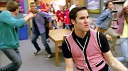 Darren Criss stuck to his classic preppy look with this pink sweater vest.