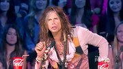 Steven Tyler's oversized silver cross pendant didn't surprise us, but the pink blouse did!
