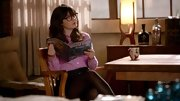 A purple gingham button down suited Zooey Deschanel's quirky personality well in 'New Girl.'