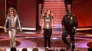 Jennifer Lopez gave her glitzy top a downtown vibe with zippered black Diamond skinny jeans.