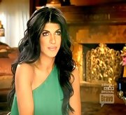 Teresa Giudice would have fit in at Studio 54 in this green pleated one-shoulder dress.