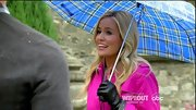 Black leather gloves punctuated Emily's Barbie pink trench.