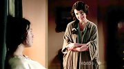 Elizabeth McGovern protected herself against Downton's drafts in a green robe.