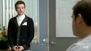 Chris Colfer looked classic wearing this handsome cardigan over his high-neck button-down.