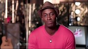 Jermaine Paul looked like he belonged on a tropical vacation wearing a straw fedora.
