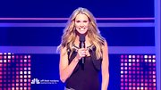 Elle Macpherson shows off her wavy locks with a classic center part.