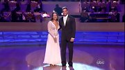 Long sleeves balanced the plunging neckline of Cheryl Burke's beaded white gown on 'DWTS.'