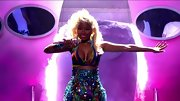 Nicki Minaj bared some skin in an '80s Barbie style bikini and glitzy high-waist skirt.