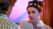 Jessica Stroup added flair to her curled updo with an exotic beaded headband.